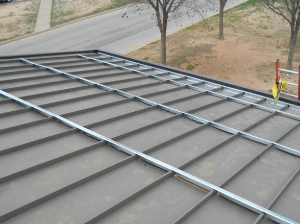 Solar thermal integrated with sub purlins by a turnkey for Energy efficient roofing