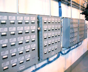 In the Park Plaza basement, 122 Class 1000 E-Mon D-Mon meters installed in multiple meter units connect via Ethernet link to the building engineer's PC, where monthly resident billing statements based on actual electrical usage are generated.
