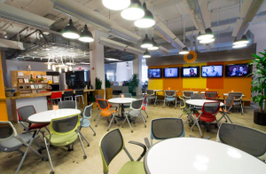 To improve interaction among employees, all segments of the LivePerson office connect at the town square, an open seating and eating zone where employees can take a break, have a discussion or hold an informal meeting. PHOTO: Dave Pinter