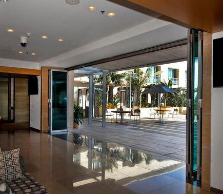 Folding doors bring the outdoors inside retrofit La cantina doors