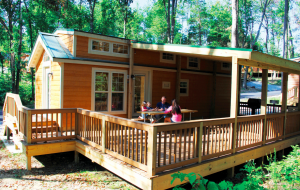 Lake Rudolph Campground & RV Resort features 53 cabins with decks that guests find appealing.