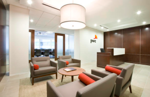 Interior renovations for Pricewaterhouse Coopers' 10,000-square-foot office suite in Richmond, Va., included framing the reception area with aluminum storefronts and double glass doors that open to ceramic tile floors accented by wood paneling along the walls.