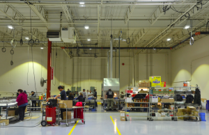 Occupancy sensors switch the fixtures off and on more often in the warehouse, where there are less people working.
