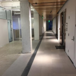 The existing bamboo ceiling panels and light fixtures will stay in place. Here Gensler focused its efforts on removing the existing carpet and, in doing so, unveiled the history and character of the building. Stone was discovered that connects from the historic elevator lobby at the circulation core.