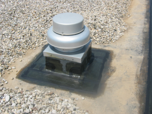 PHOTO 2: The re-flashing of roof curbs is an integral part of the restoration of EPDM roof membranes.