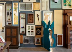The interactive wall of doors is the gateway to the student writing lab, providing various options as points of entry.