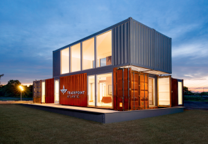 Playing on the transformative power of shipping, the modern, media-enhanced marketing center is housed in 1,400 square feet of office space built using upcycled shipping containers.