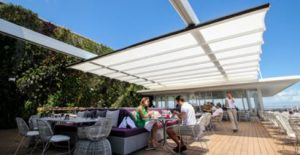 Retractable Fabric Canopy Protects From Sun Rain And