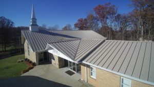 Lakeview Baptist Church replaces its deteriorating shingle roof with a standing seam metal roof.