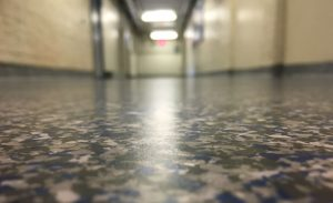The Gillespie Group completes its flooring installation project with the the AcryliCon Flake system.