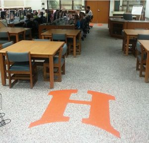 The Herculan IG 400 Epoxy system replaces carpeting in the Hurley High School, reducing allergens and maintenance costs.