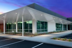 Bone White Omega-Lite ACM panels clad the renovated 4-building life sciences lab and office complex.