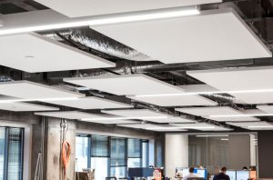 Rockfon acoustic stone wool ceiling systems are positioned strategically throughout the workspace to enhance productivity.