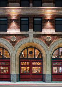 Essential historic elements were prioritized and preserved. For example, the trademark 500-pound red firehouse doors were removed, restored and reinstalled.