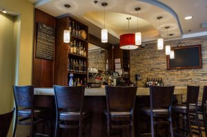 Abigail's improves its lighting system by converting the dining room to LED lamps.